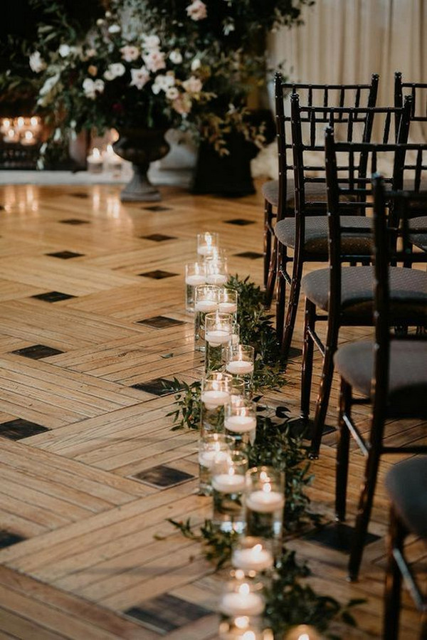 indoor wedding aisle ideas with candles and greenery