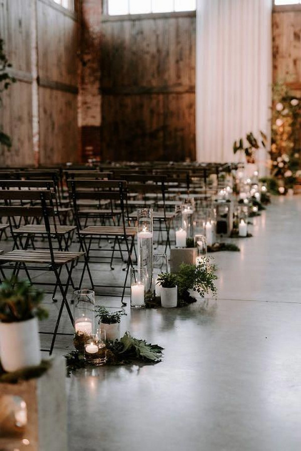 industrial wedding aisle decoration ideas with candleas and greenery