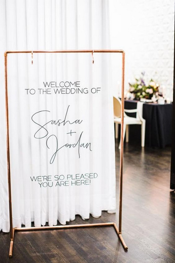 minimalist acrylic wedding sign with copper stand