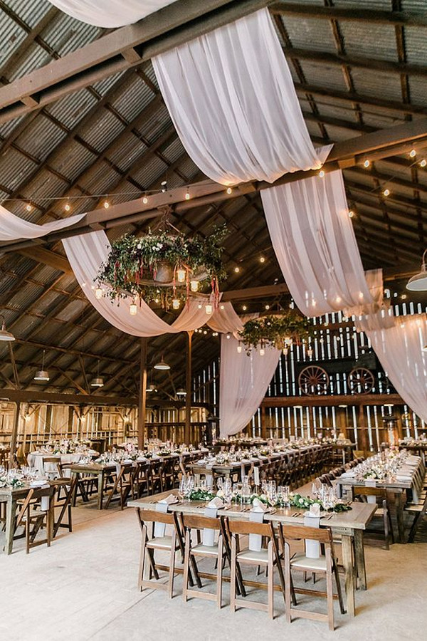 rustic barn wedding reception with drapery