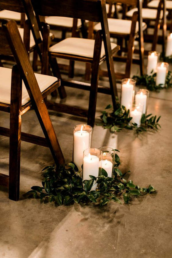 simple elegant wedding aisle ideas with candles and greenery