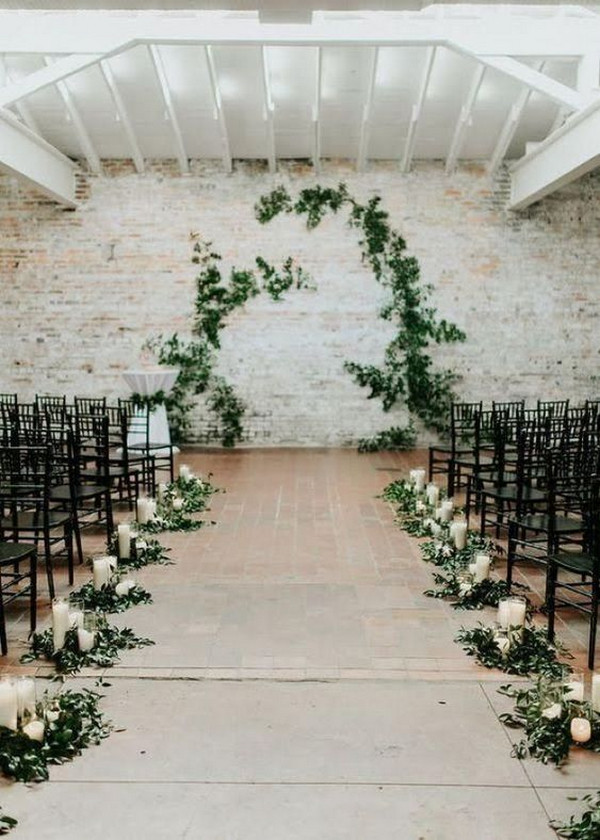 simple indoor wedding aisle ideas with greenery and candles