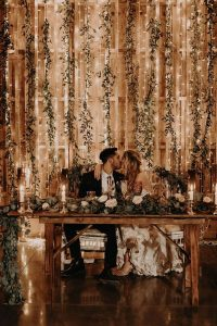 stunning wedding backdrop ideas with string lights and greenery
