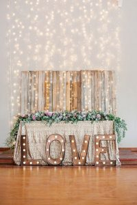 wedding head table decoration ideas with string lights backdrop