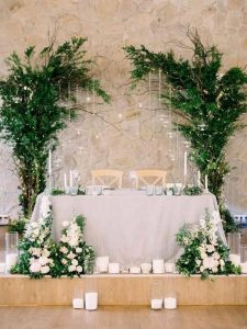 wedding sweetheart table backdrop ideas with greenery and lights