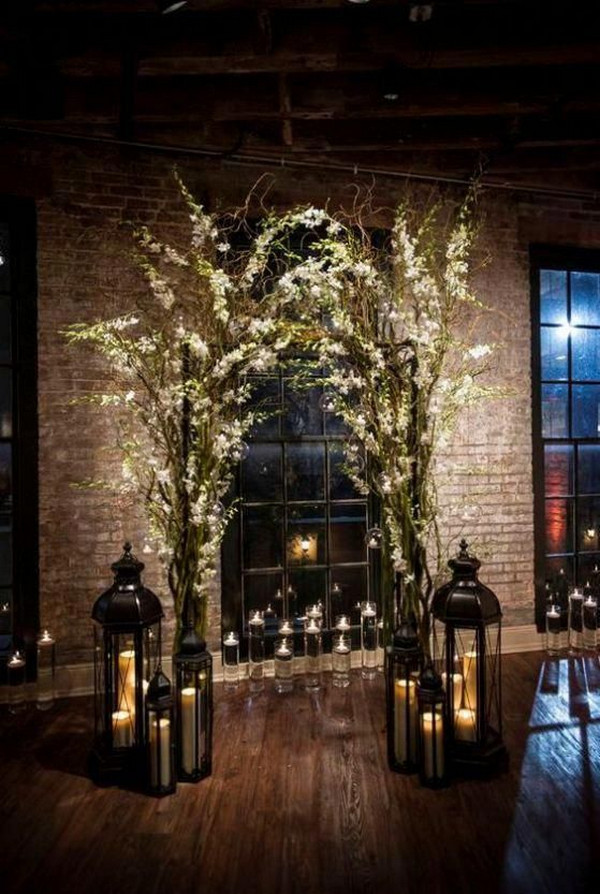 whimsical winter wedding arch ideas with candles