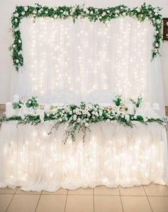 white and greenery wedding head table