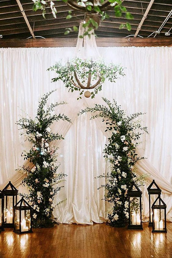 white and greenery winter wedding backdrop