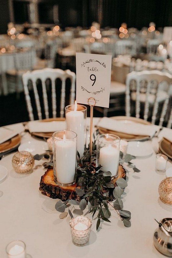 DIY vintage wedding centerpiece ideas with tree stumps candles and greenery