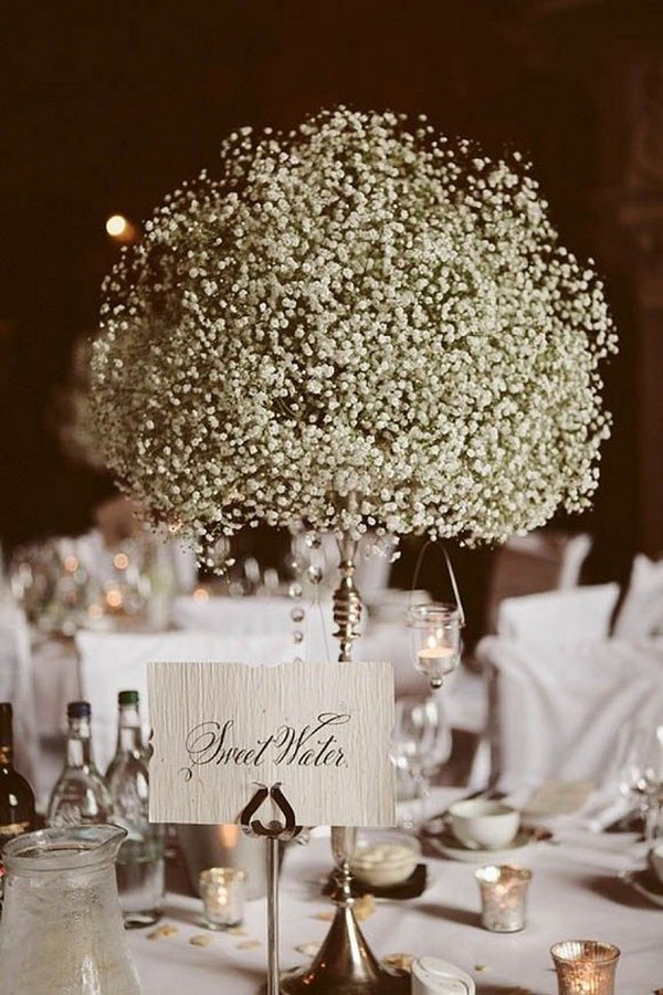 vintage tall wedding centerpiece with babys breath