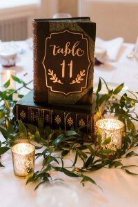 vintage wedding centerpiece ideas with books and candles