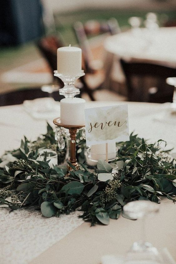 vintage wedding centerpiece with candles and greenery