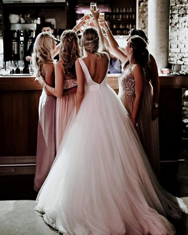 creative wedding photo with bridesmaids