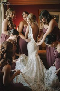 getting ready wedding photo with bridesmaids