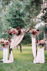 burgundy and blush outdoor wedding arch