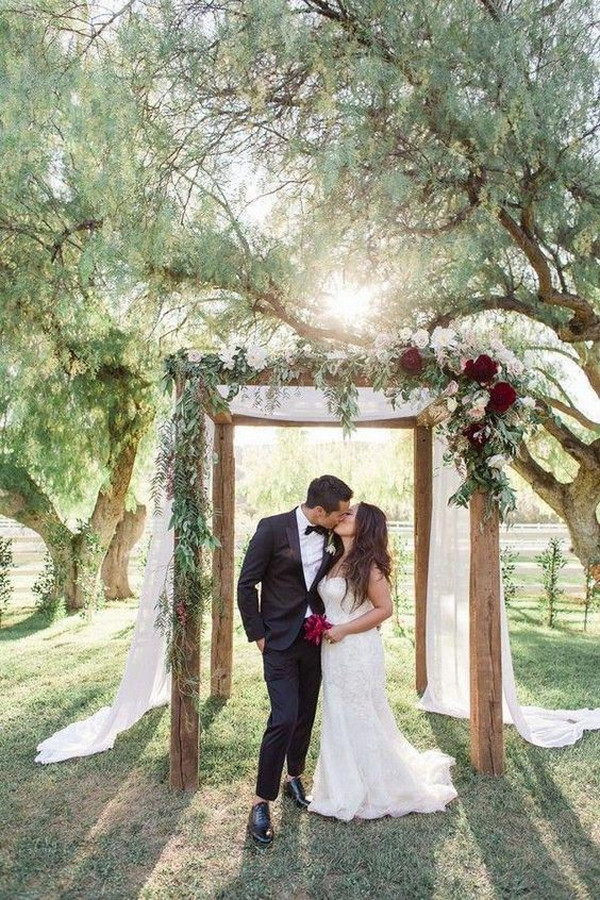 burgundy and greenery wedding arch ideas for fall 2020