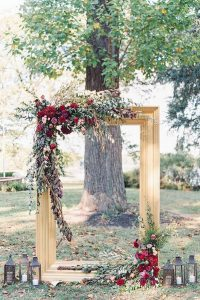 creative fall wedding arch ideas with gold and burgundy color schemes