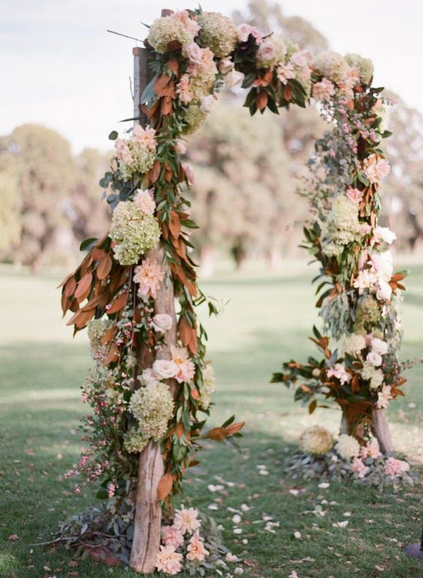outdoor floral wedding arch for ceremony