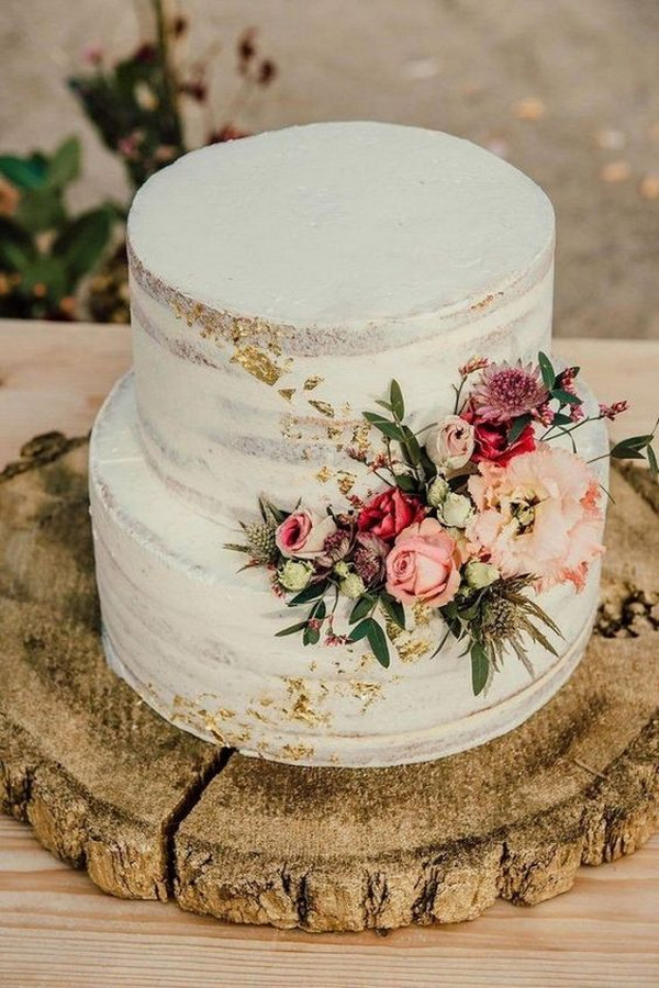 rustic wedding cake with pink floral