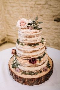 semi naked rustic wedding cake with tree stump stand