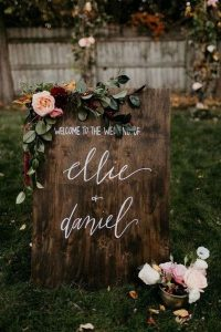 boho rustic wooden wedding sign ideas with blush pink flowers