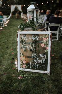 outdoor boho farm wedding ceremony sign