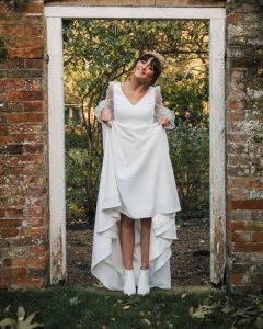 White wedding ankle boots with simple wedding dress