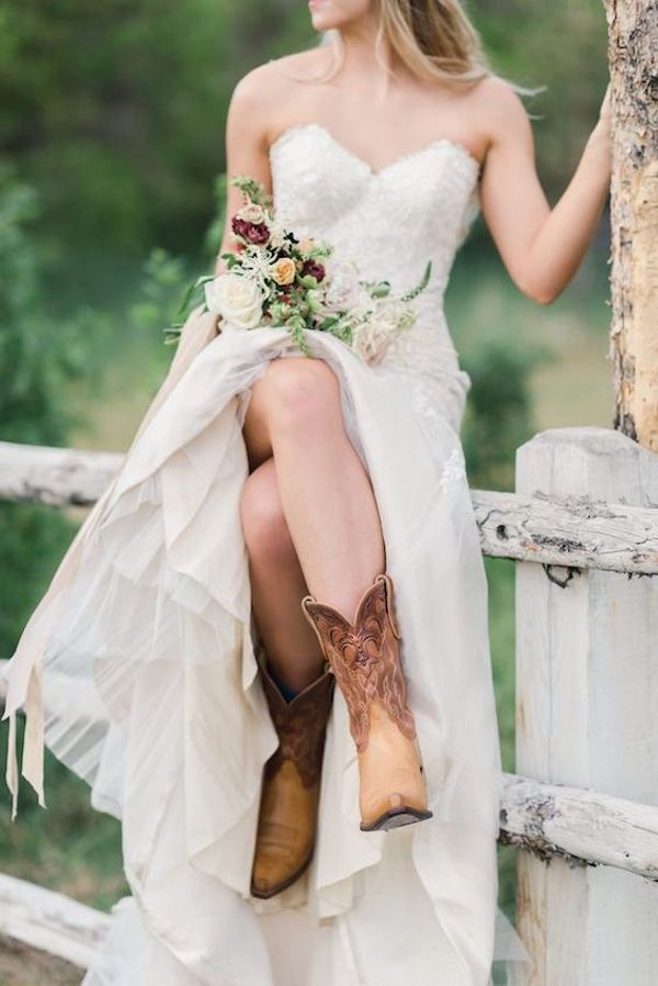 country rustic wedding dress with cowgirl boot