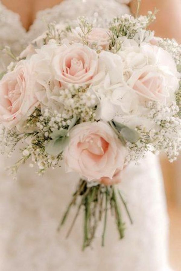 pink rose and baby's breath wedding bouquet