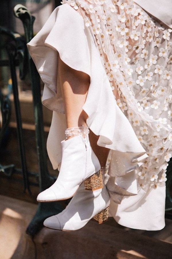 trending white boots as wedding shoes