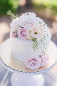 one tier small wedding cake with flowers