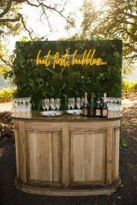 outdoor wedding bar ideas with neon sign
