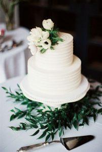 simple elegant white and greenery wedding cake