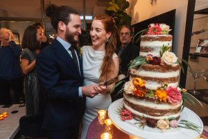 Bride, groom, and cake